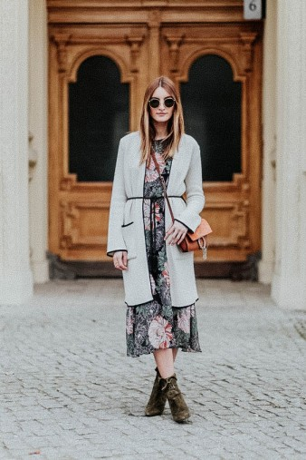 BERLIN, GERMANY - MARCH 29: Fashion blogger Sofia Grau is wearing a green pink dress with floral print and grey long cardigan from Zara, bag Chloe Faye, belt vintage, sunglasses Rayban, olive shoes Aquazzura tribeca boots on March 29, 2016 in Berlin, Germany (Photo by Christian Vierig/Getty Images) *** Local Caption *** Sofia Grau
